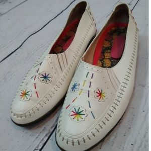 White leather hush puppies with rainbow embroidery